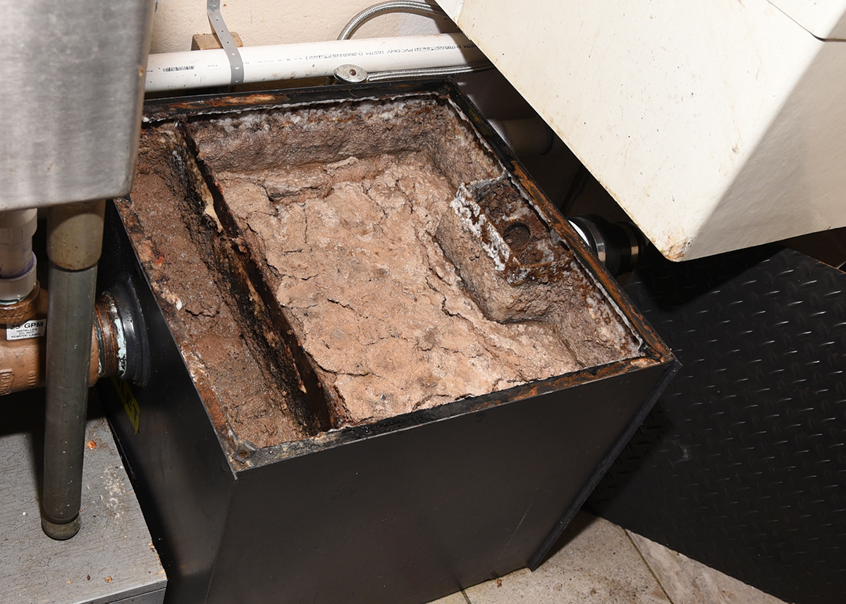 Grease trap that is full.